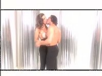 Парень и девушка слились в потоке страстных обьятий
