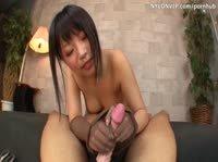 Худая азиатка в колготках дергает резиновый пенис